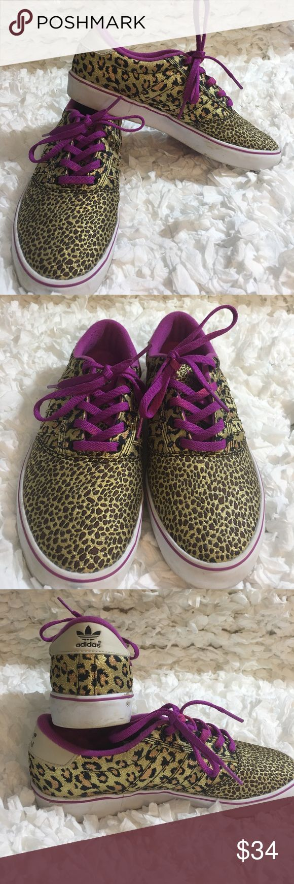 Adidas Leopard print sneakers size 7 1/2 Excellent condition Adidas shiny leopard print sneakers. Purple shoe strings. One shoe string has Light area of purple. Please look at picture prior to purchase. Unsure if this is the way shoestring came. Shoe in excellent condition. adidas Shoes Sneakers