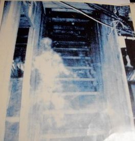 """The photos posted above come from Bobby Mackey's Music World in Wilder, KY, a.k.a. """"the most haunted nightclub in the U.S.A.""""   The picture on the left shows a ghost climbing a now-barricaded staircase."""