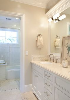 "Neutral bathroom paint color ""Benjamin Moore Berber White 955″ AND love the neutral floor tile"