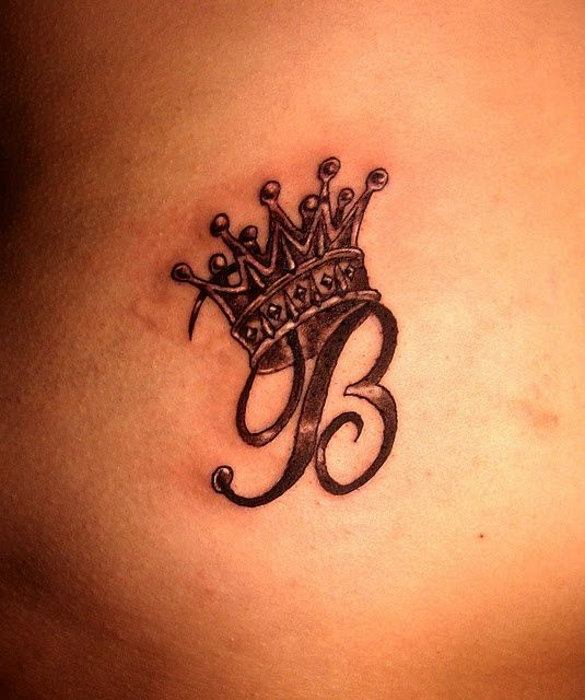 Initial wearing crown tattoo