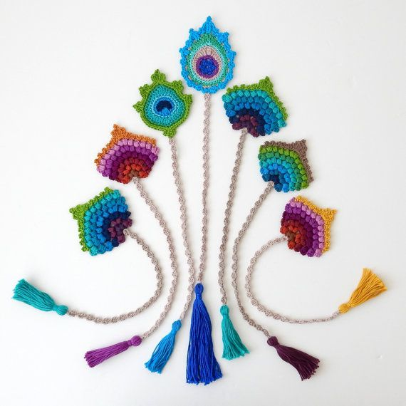 This is a listing for 1 crocheted bookmark. It is the finished item and not a pattern. This one is READY TO SHIP. This crochet bookmark in the form of a peacock feather would make for a lovely and original birthday, teacher or Christmas gift. It is my original design and has been handmade by me. For more original gifts, please see the Handmade by me Section in my shop: https://www.etsy.com/shop/TheCurioCraftsRoom?ref=hdr_shop_menu§ion_id=19119315 Measurements: Peacock feather approx. 8.5 x…