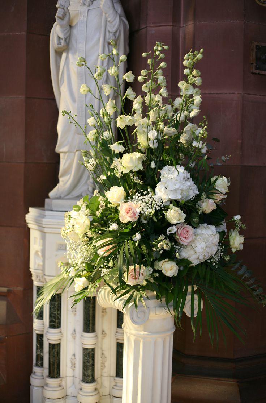 Church pedestal arrangement with white delphiniums