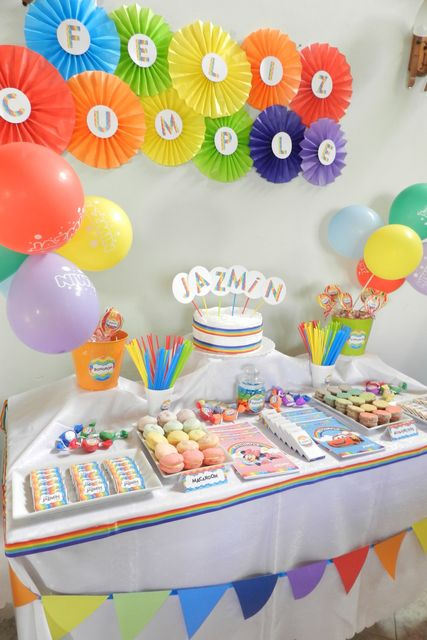 Rainbow dessert table  I like the idea of putting the circles up along the bridge with each troops number on it who are bridging!