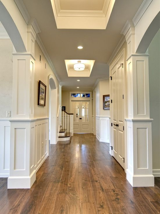 , Attractive Traditional Hallway Design Ideas Also Light Slate Blue Wall Paint Color Also White Wooden Wall Also Brown Floorboard And Elegant Ceiling Light Also White Classic Double Door And Staircase: Hallway designs to Make Your House Better