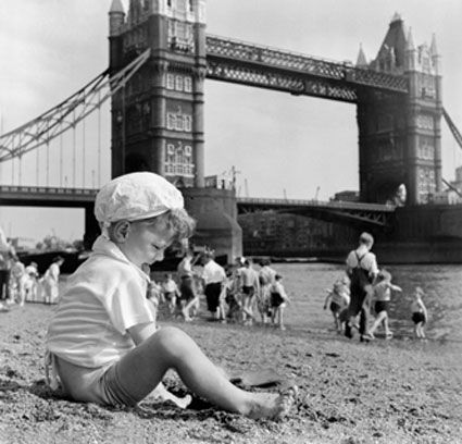 Londoners relax on Tower Bridge © Henry Grant   there was even a beach in London which opened in 1934. The Tower of London Children's Beach, or Tower Beach, was created by transporting more than 1,500 tons of sand to the Thames' north foreshore near Tower Bridge. It was very popular, attracting hundreds of thousands of people, even though the river's tide meant that the beach was only open for a couple of hours a day. The beach finally closed in 1971 due to pollution in the river.