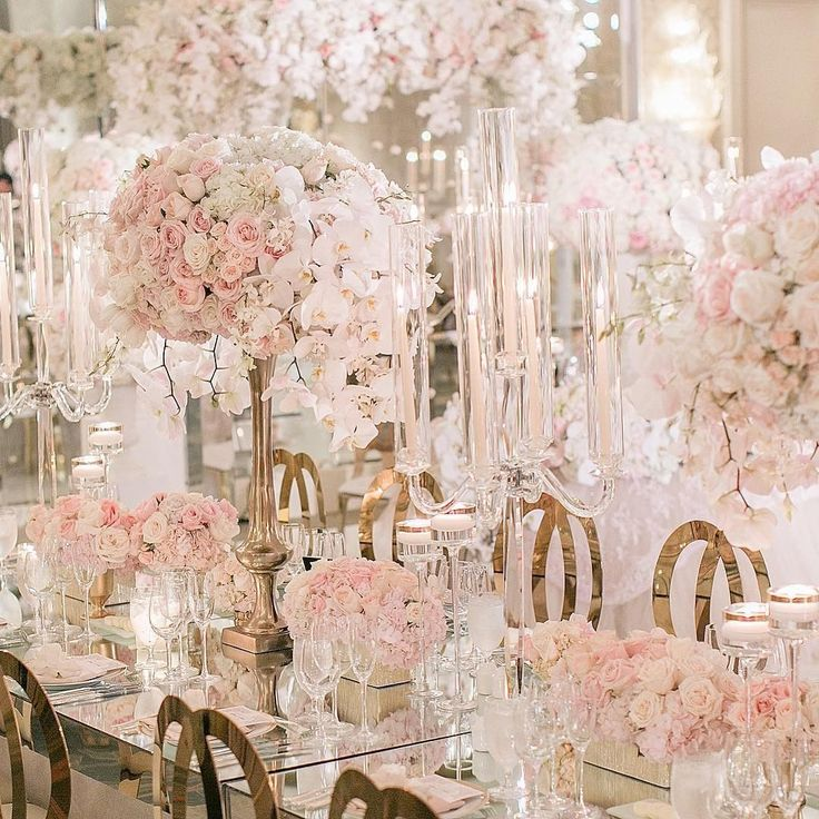 A walking through a wonderland of overflowing florals! Blush, white and gold Wedding Reception. | Katia Beverley Photo