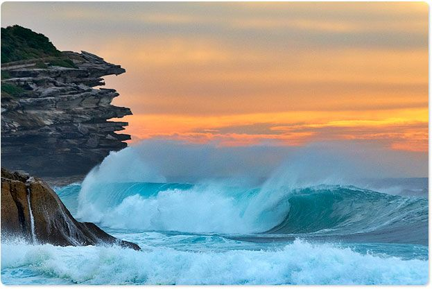 Dawn behind the swell...love this pic.