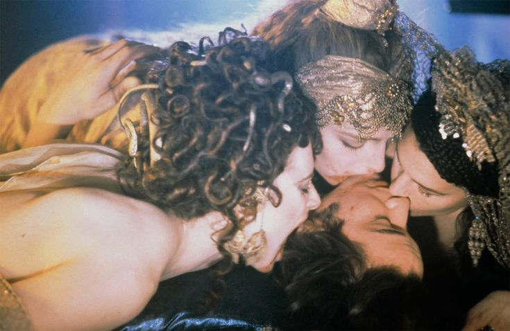 http://illusion.scene360.com/movies/69337/erotic-horror-movies/ Keanu Reeves seduced by the brides (including monica bellucci) in bram stoker's dracula
