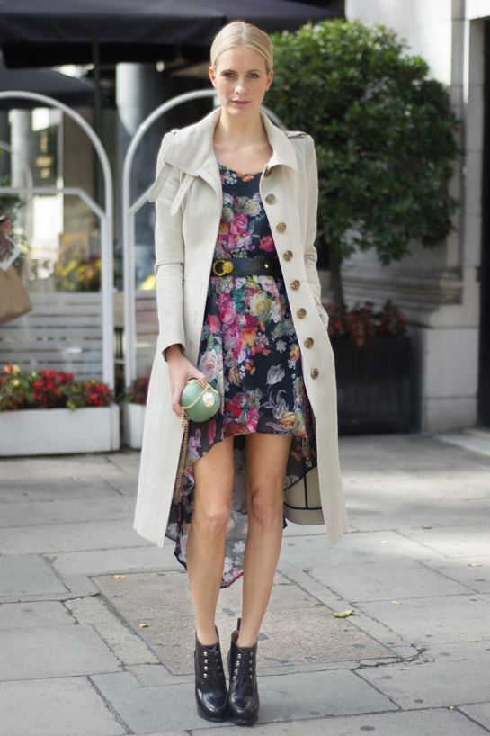 Streetstyle: Poppy Delevingne wearing a printed floral dress and trench coat from Vogue