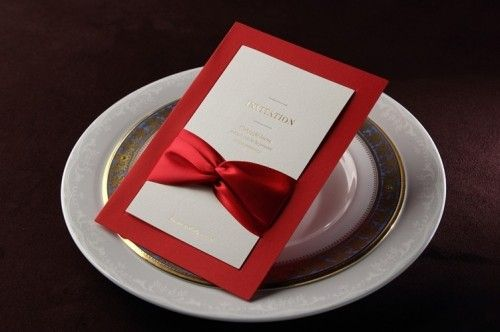 An elegant and classy design invitation , for a business affair, and engagement or wedding. Wow your guests with this elegant invite. A red double bow detail at the front front gives it a classic look