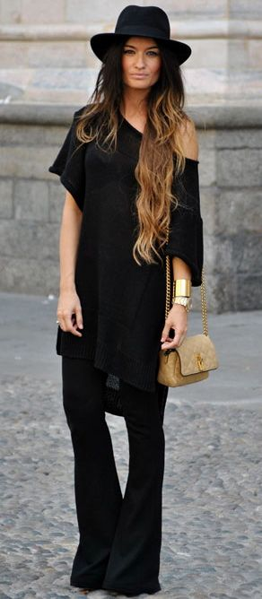 Create long lines in an oversized t-shirt and striking flared pants.-- love the look, wish I was a hat person