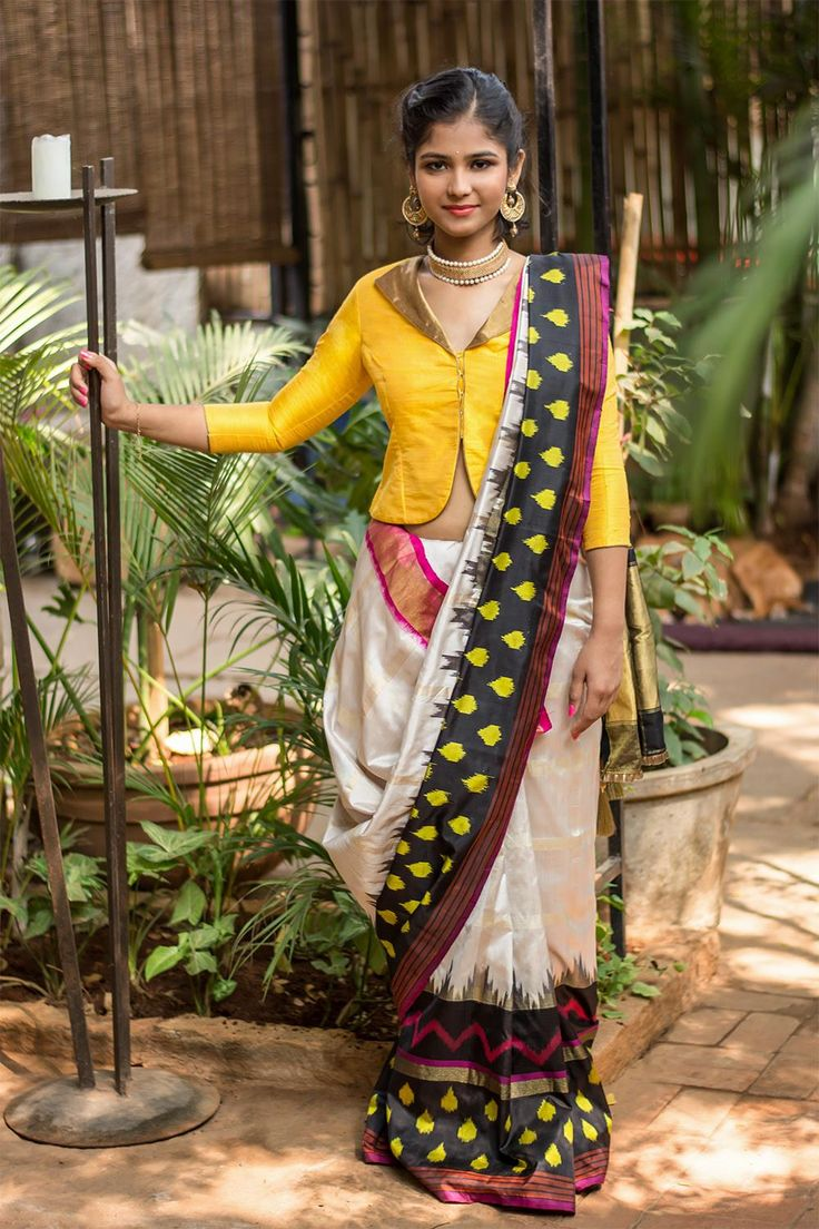 This saree is a true desi girl. Colorful, Ikat print, Pochampally Silk - perfect concoction for this festival season. The bright hues of black, yellow against the pink border works perfect with the elegant cream saree to give you the perfect ensemble. Work her with a hot pink blouse or lay low with a neutral gold blouse - either way you have a winner in this saree! #saree #pochampally #ikkat #handloom #indian # saree