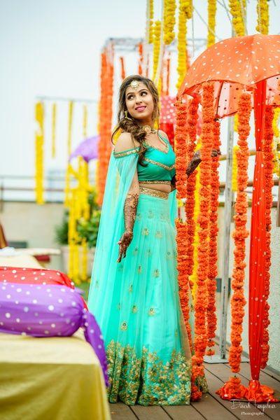 Mehendi Outfits - Light Blue Net Lehenga with Open Sleeve Blouse   WedMeGood #wedmegood #indianbride #indianwedding #bridal #lehenga #net #blue #aquablue #mehendioutfit #indianweddingoutfit