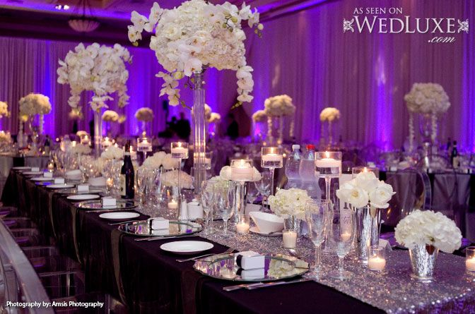 WedLuxe: all-white #floral centrepieces in high and low arrangements