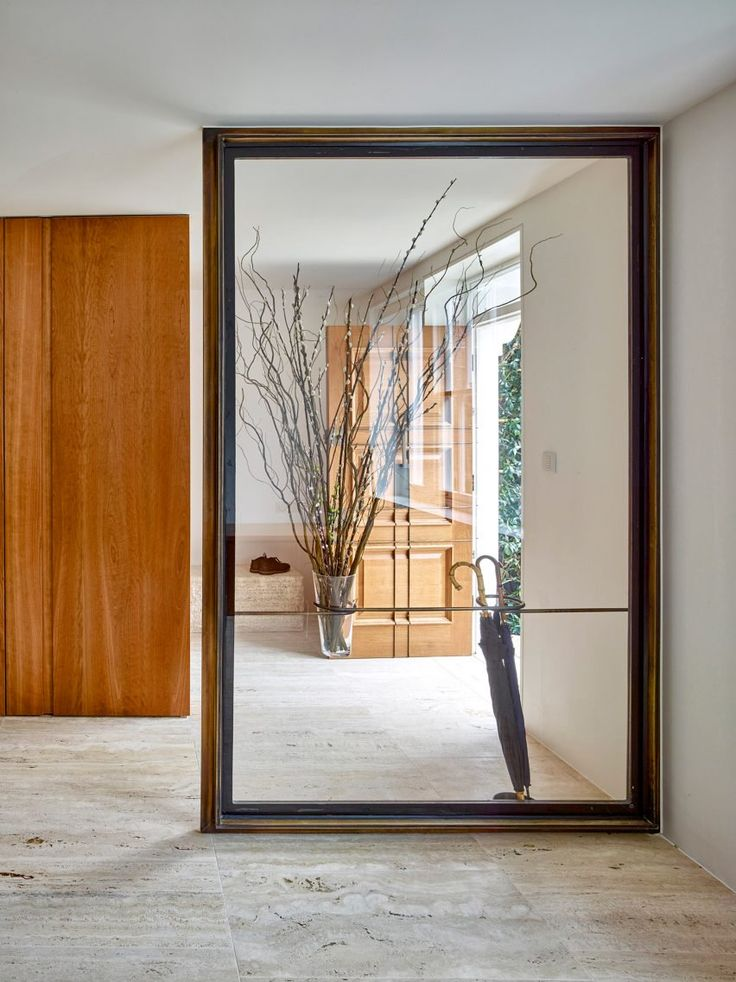 London studio Amin Taha Architects has updated a 1950s terraced house in the city's Bayswater neighbourhood, adding a basement level topped with a rugged concrete soffit and a lightwell set into a courtyard garden.