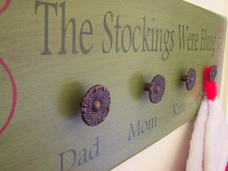 "Personalized Stocking Holder  Wooden Sign 8"" x 24"" With Free Santa Key - Christmas Customized Stocking Holder. $45.00, via Etsy."