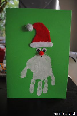 Hand print Santa. (Maybe move the eyes/hat lower onto the hand but cute either way!)