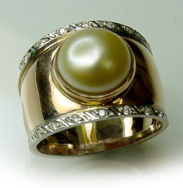 Custom made Rose Gold ring with Creamy South Sea Pearl and white gold and Diamond details.