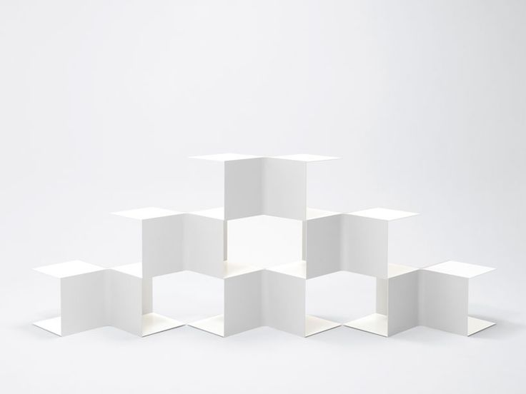 click images to enlarge  I love these new bookshelves designed by Nendo. They're the latest addition to their dancing squares collection – an investigation into the possibilities of square planes – which they released earlier this year. Below are 2 different arrangements but the shelves can be i