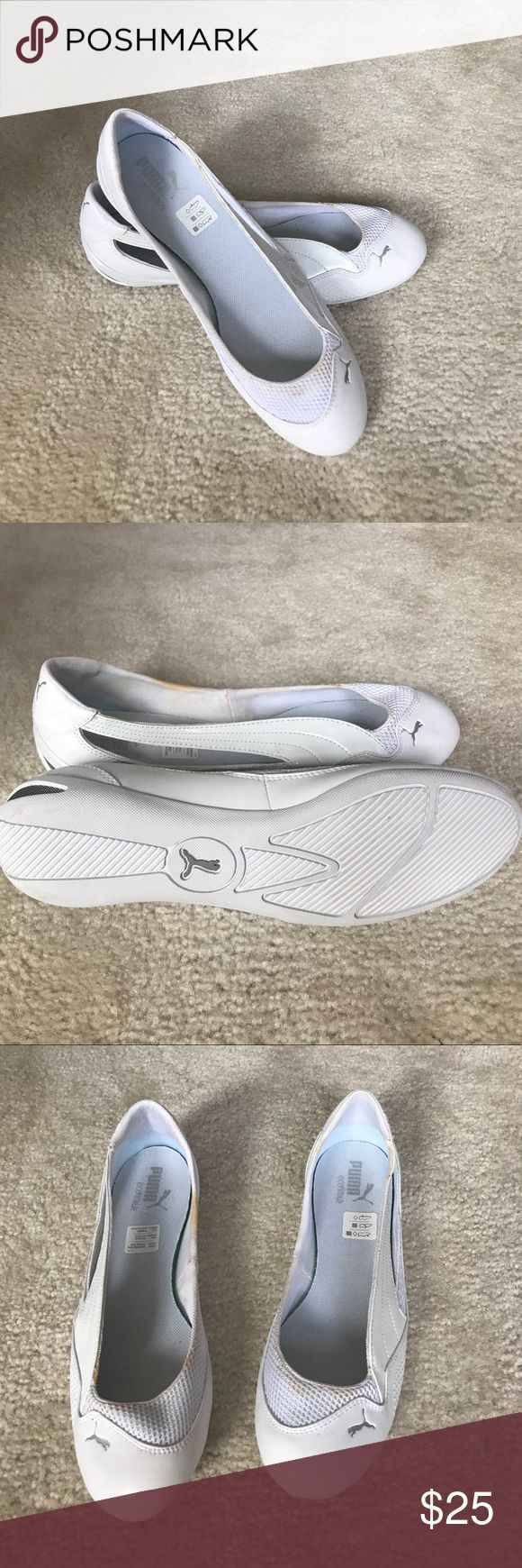 Size 9 women's Puma all white flats Never worn, but now showing small yellow stains around the edge of the shoes (as seen in the pictures).  As the soles show, and the stickers still in the shoe, they have never been worn. Puma Shoes Flats & Loafers
