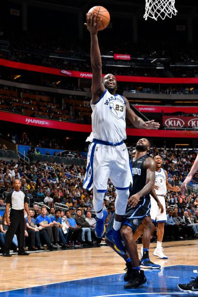 Draymond Green of the Golden State Warriors shoots the ball against the Orlando Magic on December 1 2017 at Amway Center in Orlando Florida NOTE TO...