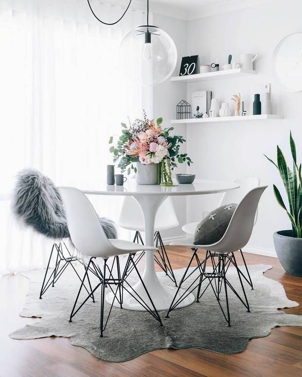 sheepskin white dining room with cowhide rug