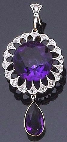 An amethyst and diamond pendant necklace The circular mixed-cut amethyst, within an openwork surround of millegrain-set rose-cut diamond detail, suspending a pear-shaped amethyst drop, to a later detachable trace-link chain, lengths: pendant 3.4cm., chain 23.4cm., fitted case