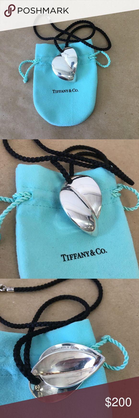 Tiffany & Co Silver Frank Gehry XL Heart Necklace! Tiffany & Co. .925 Sterling Silver Frank Gehry Large Heart Pendant Necklace Inventory #  6183-15 Everything we sell is 100% guaranteed authentic! We list dozens of items every day, so check our other listings out! We are Meta Exchange, a resale store in Baton Rouge, LA! Sorry, no trades. REASONABLE offers will be considered. We ship same/next day. Thanks! Follow us: FB metaexchange  IG meta225 Tiffany & Co. Jewelry Necklaces