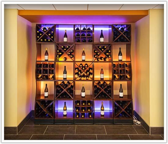 """Circular Merchandisers And Curvy Cubes Spell Unique Wine Cellar Style - Want to update your wine store with a totally unique look? Take a leaf out of today's DIY feature! """"The online instruction video and the printed materials that come with the kits are easy to follow. All of the pieces were custom ordered with triple lacquered and looked beautiful. However, some were not packaged correctly and stuck together. Those pieces were promptly replaced at no charge."""" ~Laurie P.~"""