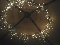 1 hula hoop (spray painted) + 2 strings of icicle lights and duct tape = outdoor dining area chandelier.