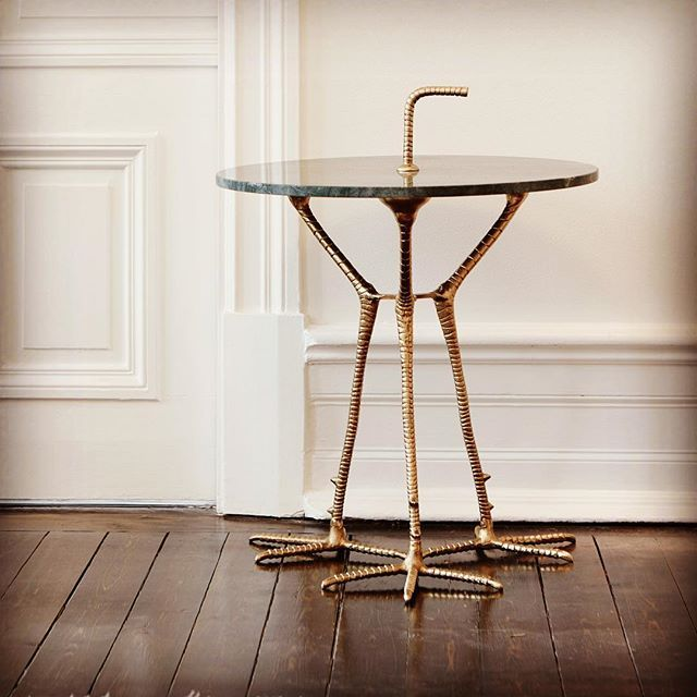 Mastella Green Marble and Brass Bird Leg Table. Forget Beijings bird's nest stadium - this Swedish designed brass bird legged table is a real modern world wonder - drawing avian inspiration with its distinctive triple legged design that combines the luxe