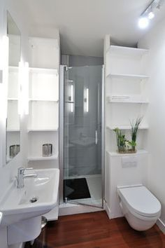 I never would have thought of hiding the shower behind the 'commode' like this, because of the ventilation factor. But a window in the shower would fix that and also add light.    Wait, there's a washing machine in there, too??? (see notes below)