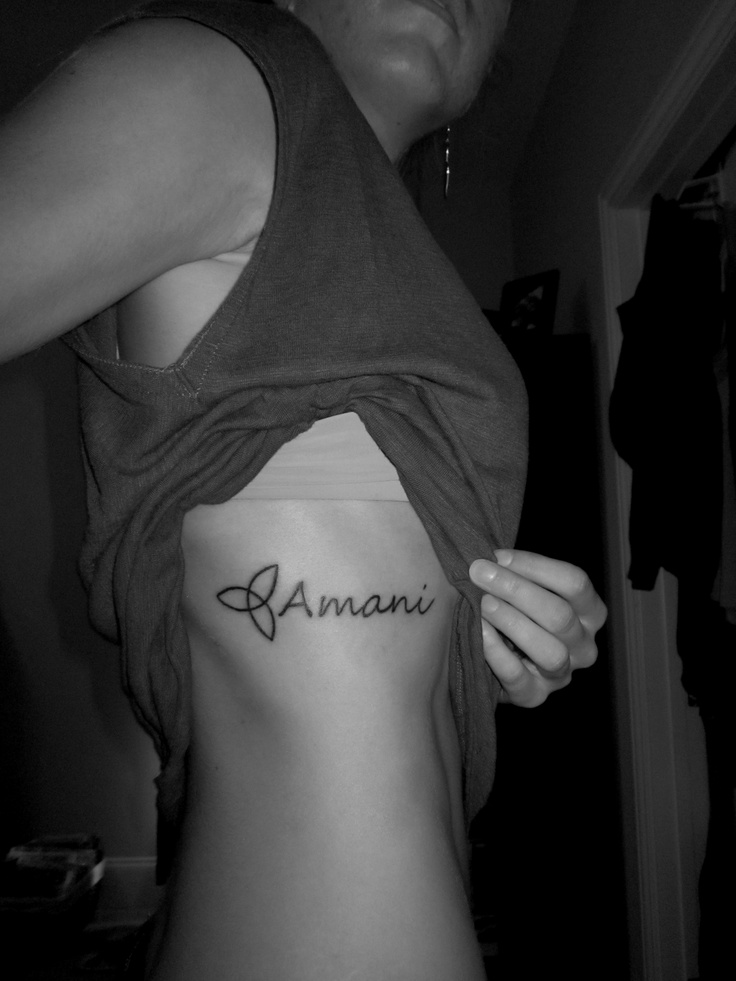 My new tattoo that I got today on my ribs! The trinity symbol. 'Amani' means peace in Swahili. God is the One who brings true peace to your life in all situations. I got it in Swahili because of my heart for Africa :)    (tattoo, ribs, trinity symbol) (*photo rights belong to Liz Thornton)