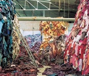 mountains of 'waste' clothing (image from 'Everything Must Go' exhibit in london)