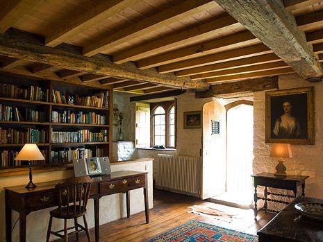 Very cozy cottage room-beamed ceilings, wood floors, books A Joyful Cottage: Monk's Hall