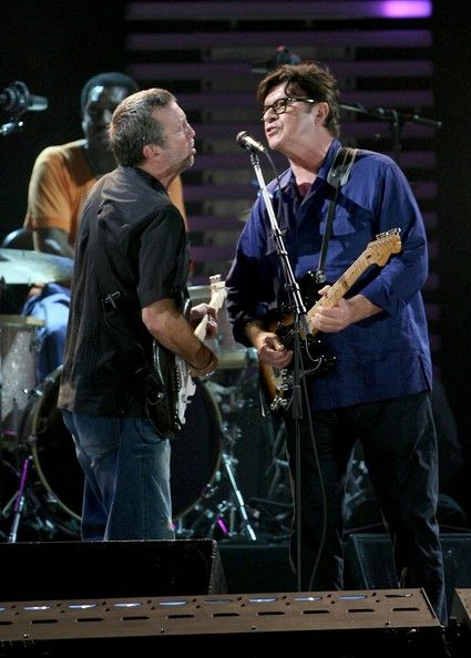 Eric Clapton performing with Robbie Robertson and drummer Steve Jordan during the Crossroads Guitar Festival 2007 held at Toyota Park on July 28, 2007 in Bridgeview, Illinois.