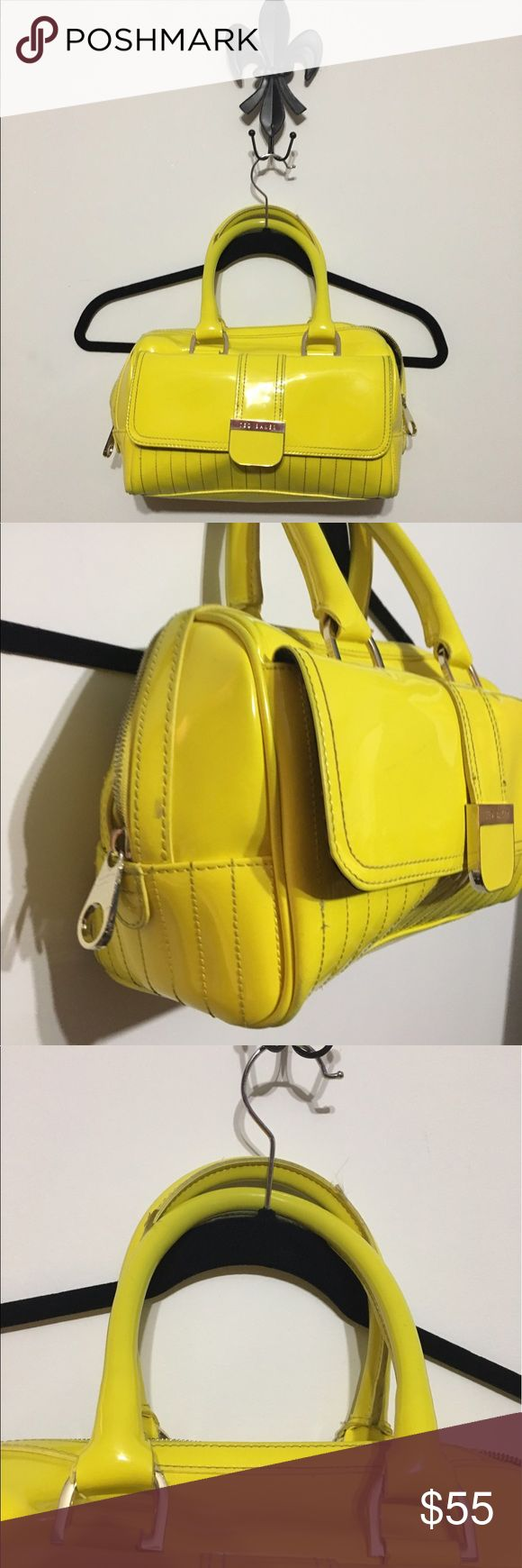 Ted Baker Vibrant Yellow Patent Satchel handbag Ted Baker Vibrant! Yellow Patent Gold Bulldog Bowler Drs Handbag Purse Purchased from Nordstrom. In good condition except for: -There are some marks on the bottom as shown in the pics. -The plastic that covers the seams on the handle is coming off as shown in the pics.  Don't forget to check out my other designer items. I'm cleaning out my closet's.   Please note all sales are final 😊 Thank you for viewing🎀 Ted Baker Bags Satchels