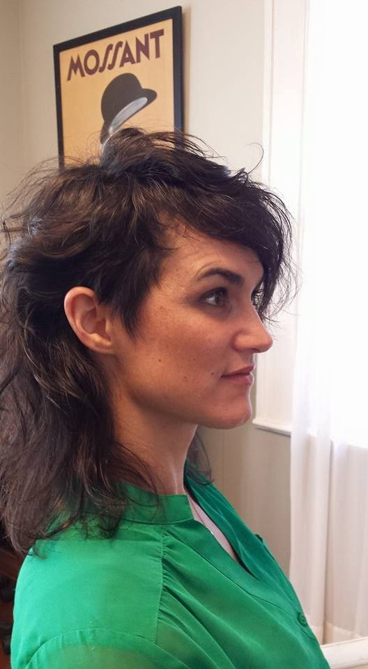 Euro mullet with asymmetrical bangs.