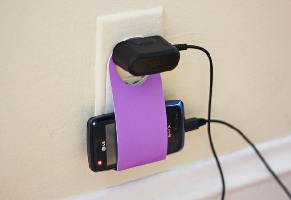 Cradle your cell phone in this cardboard charger holder by following the template here.
