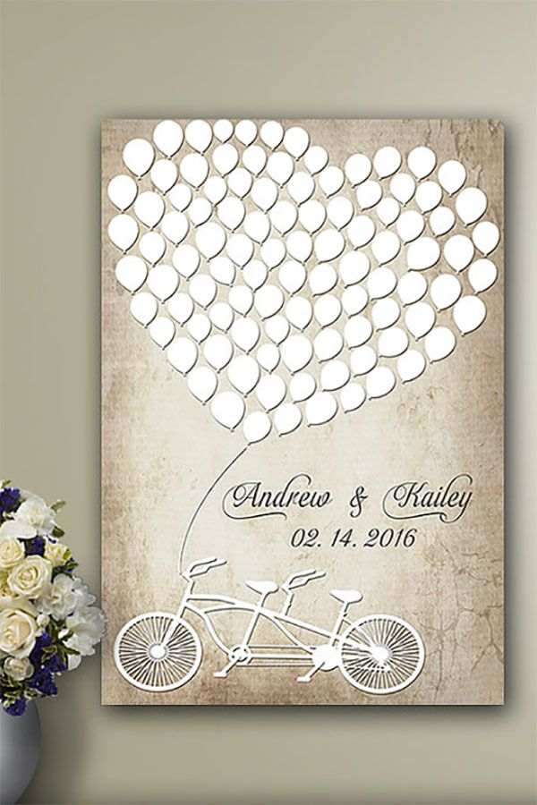 Whimsical guest book alternative. It's a rustic-look balloon heart and bicycle built for two to remember your wedding guests by.