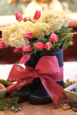 Adorable tulip bow spring centerpiece. This would be easy to make using children's rubber boots, I would put a small vase in boots a tie with a ribbon :) so cute