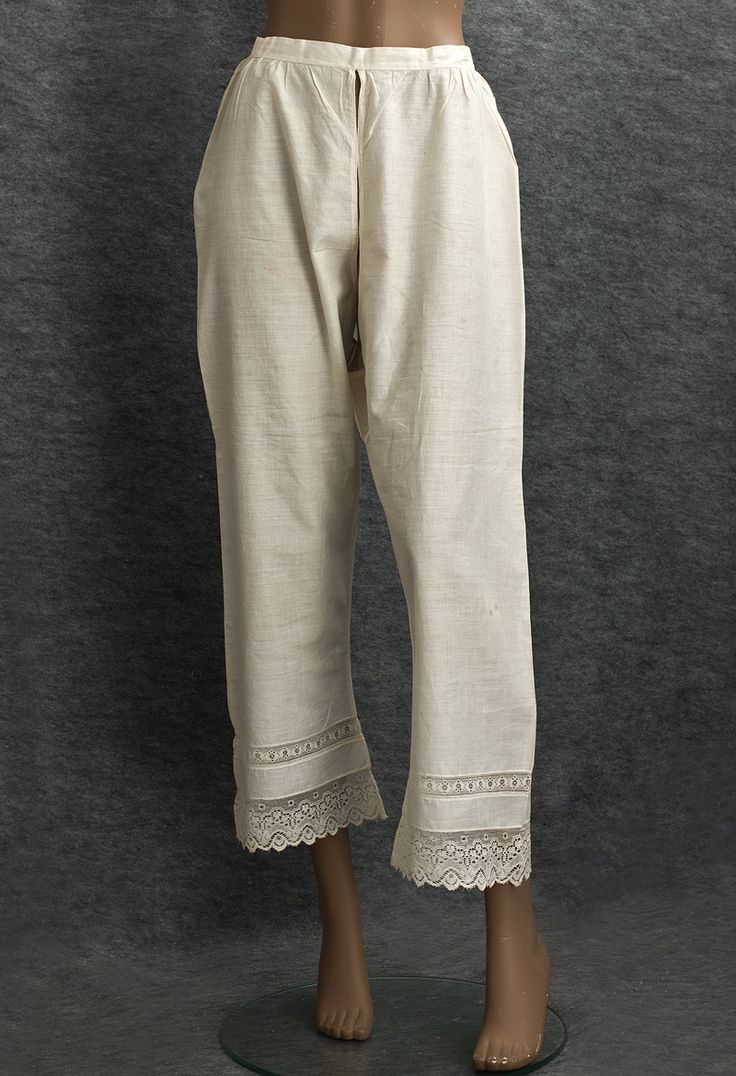 Woman's lace-trimmed pantalettes, 1820s. This pair in top condition is a special find for the serious collector.  The pantalettes consist of two separate legs attached to a waistband, leaving the crotch open. The legs are bordered at the bottom with bands of needle run lace.  The pantalettes are completely hand stitched and close in back with one mother-of-pearl button. The open edges of the crotch are finished with corded piping.