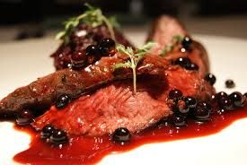 Venison with  sloe gin and berry reduction.