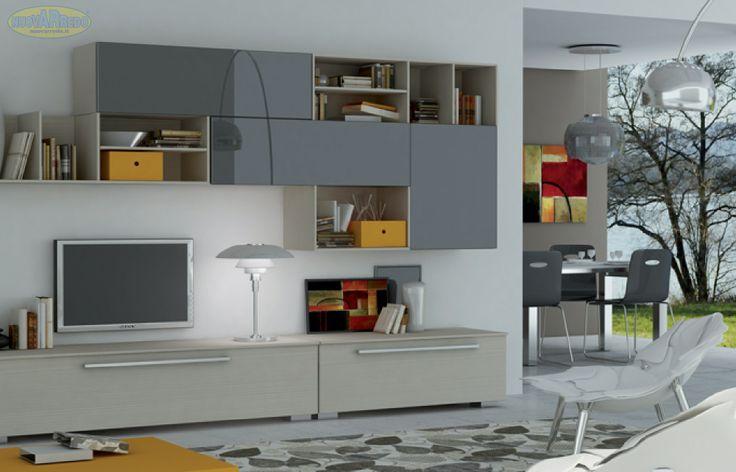 Prezzo: € 899 Parete attrezzata mod. Vision finitura in larice beige con frontali laccato grigio Dimensioni: L.300 P.60
