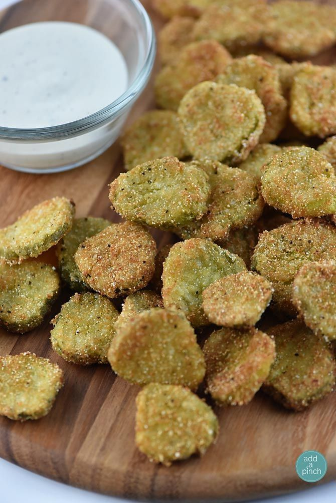 Fried dill pickles make a delicious treat! Made with just a few simple ingredients and ready in minutes, these are a definite crowd favorite!// addapinch.com