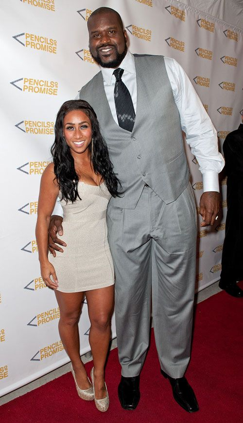 """Height Difference: Nicole Alexander and Shaquille O'Neal Basketball great Shaquille O'Neal started dating reality TV star Nicole Alexander back in the summer of 2010. Nicole — or ""Hoopz,"" as she's more commonly known — is famous for winning the VH1 reality TV shows Flavor of Love and I Love Money. Shaq and Hoopz win the prize for biggest celeb couple height difference: At 5'2"", she's a full two feet shorter than her guy, who's a veritable giant at 7'1''."""