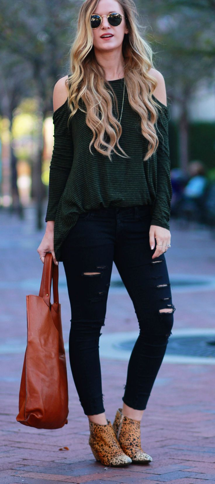 Casual fall outfit styled with open shoulder striped top, black distressed jeans, Matisse leopard booties, and leather tote