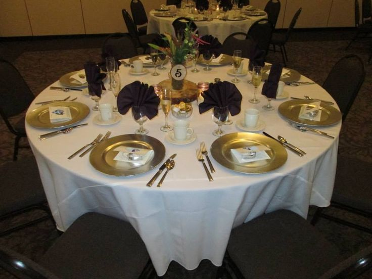 Eggplant Napkins White Tablecloth And Gold Charger Plate
