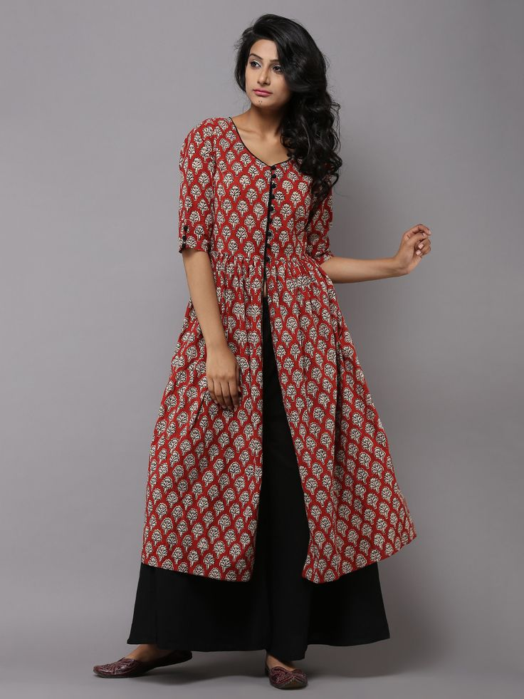 Description: Red Block printed dress, closed till the empire line and slit waist-down, to be worn as a dressy cape over a flared skirt or fitted pants to…