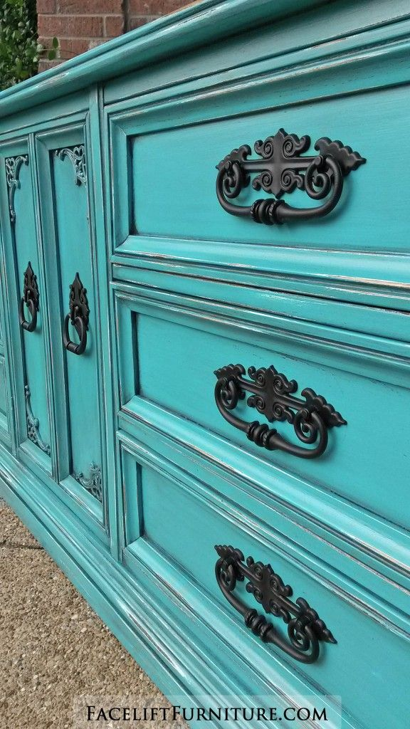 distressed turquoise dresser with ornate black pulls from facelift